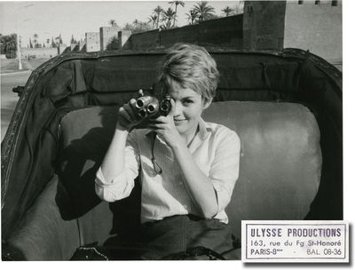 France: Ulysse Productions, 1964. Vintage borderless photograph of a playful Jean Seberg pointing he...