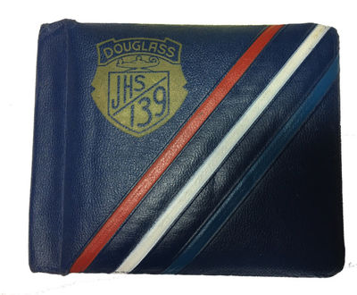 n.p.: n.p., 1944. Hardcover. Very Good. Blue padded autograph book from Douglass Junior High School ...