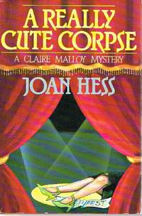 A Really Cute Corpse: A Claire Malloy Mystery by  Joan Hess - Stated First Edition. First Printing - 1988 - from Round Table Books, LLC and Biblio.com