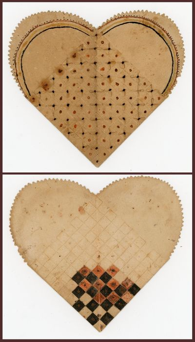 . Age toning and light wear.. An intricately woven paper pocket cut in the shape of a heart with saw...