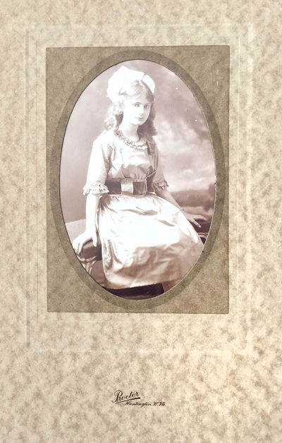 Huntington, WV: Proctor, 1910. Fine. Silver gelatin photograph mounted in a folding brown paper card...
