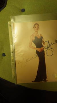 Sharon Stone , Beautiful Thin Hollywood Actress Color Photograh , SIGNED in Black Ink, Standing Wearing Elegant Long Black Evening Dress with Short Blonde Hair & Red Lips, & Diamond Bracelet