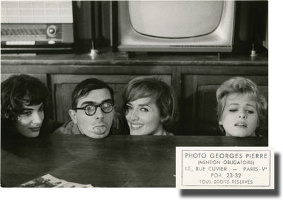 Paris: Paris Film, 1960. Vintage borderless photograph of director Claude Chabrol goofing about with...