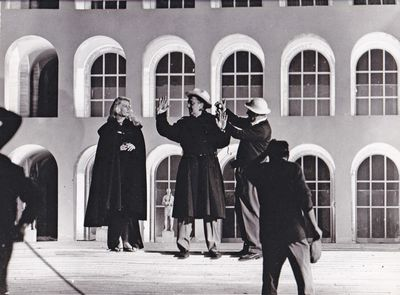 N.p.: N.p., 1962. Vintage borderless reference photograph of Federico Fellini directing actress Anit...
