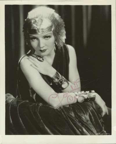 No binding. Very Good. 254 x 206 mm. Wearing headdress from her role in the 1934 film, Cleopatra Sli...