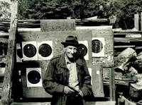 ORIGINAL PHOTOGRAPHIC PORTRAIT OF WILLIAM BURROUGHS, INSCRIBED BY THE PHOTOGRAPHER