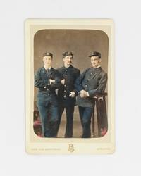 A hand-coloured cabinet photograph (image size 133 × 90 mm) of three men in uniform. The...