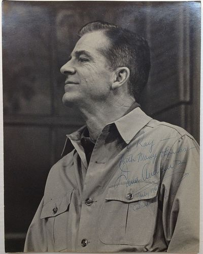 1962. unbound. 14 x 11-inch black-and-white photograph, depicting the actor in a rugged pose, glanci...