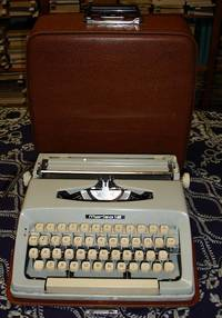 MARIZA 12 (MARITSA 12)  Portable typewriter with a Greek keyboard  Metal  body  Carriage of 25 cm  Dating from the 60ties  Measuring 31x31 cm,  weighing