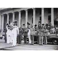 [The Japanese Surrender at Singapore] I: Admiral Mountbatten inspecting the naval guard of honour outside the Municipal Building. II: Admiral Mountbatten leading the cheers for His Majesty the King.