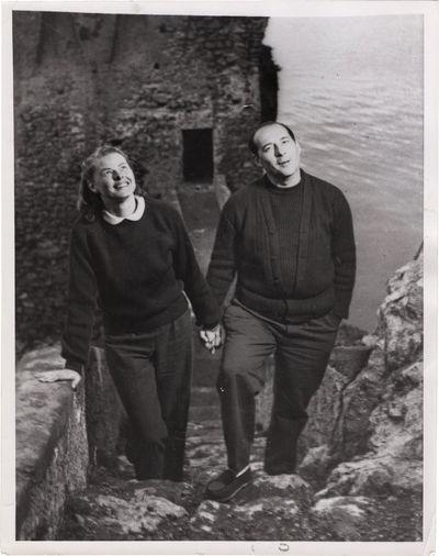N.p.: N.p., 1959. Photograph of Ingrid Bergman and Roberto Rossellini walking hand in hand on Stromb...