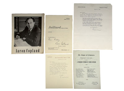 Rare collection of three programs and two typed letters signed by American conductor Aaron Copland. ...