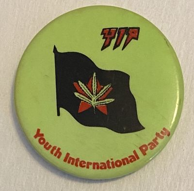 n.p.: Yippies, n.d.. 1.5 inch pin, flag with red star and marijuana leaf.