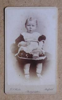Carte De Visite Photograph. Portrait of a Young Girl Holding a Basket.