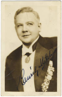Waist-length photograph in formal attire, signed in full