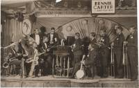 """Original photograph; of 11-piece band posed on the stage of Savoy Ballroom beneath the sign """"Bennie Carter and his Savoy Playboys"""" by (Carter, Benny) - 1928"""