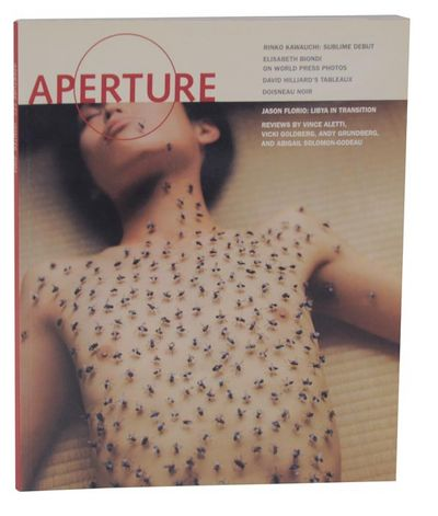 New York: Aperture, 2004. First edition. Softcover. Winter 2004. Features work by: Robert Doisneau, ...