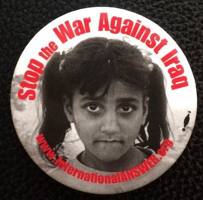 n.p.: International ANSWER, . 2.25 inch diameter pin, face of a young girl.
