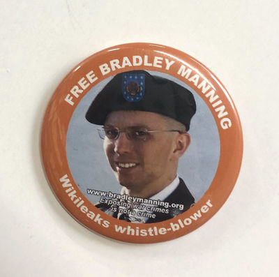 n.p.: BradleyManning.org, 2011. 2.25 inch diameter pin, portrait of Manning before coming out as Che...