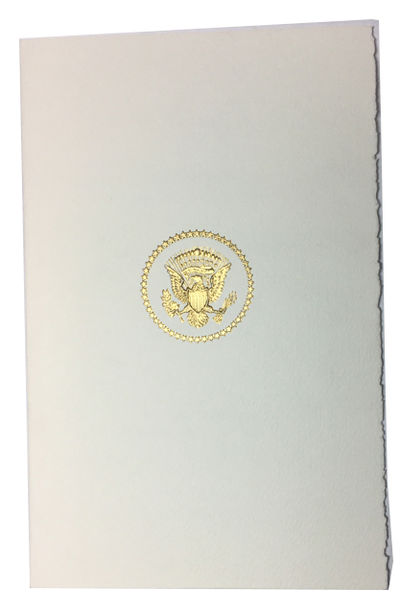 , 1994. Fine. White card stock outer folder with Seal of the United States printed in gold on front....