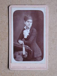 Carte De Visite Photograph: Portrait of a Young Woman Holding a Fan.