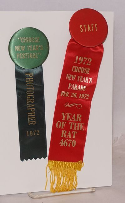 San Francisco: , 1972. Two pinback buttons with ribbons attached, one marked