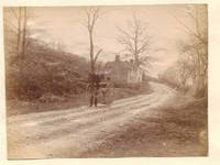 Man with Tricycle on country lane.