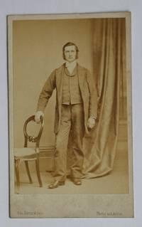 Carte De Visite Photograph. Studio Portrait of a Gentleman Beside a Chair.