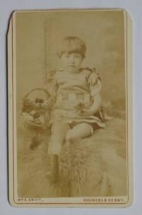 Carte De Visite Photograph. Studio Portrait of a Young Child with a Basket of Flowers.