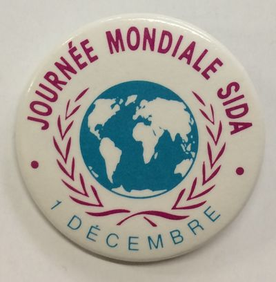 n.p.: Eloctex, inc, n.d.. 1.5 inch diameter pin, world map with laurel wreath on white field, very g...