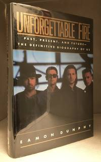 Unforgettable Fire; Past, Present, and Future - the Definitive Biography of U2 by  Eamon (Biography of U2--Band; Includes Bono; Adam Clayton; Edge; Larry Mullins.) Dunphy - Hardcover - from Burton Lysecki Books, ABAC/ILAB (SKU: 154183)