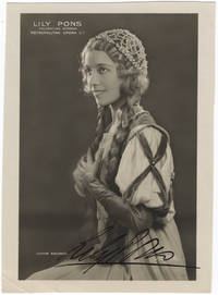 Waist-length role portrait photograph as Gilda in Rigoletti. Signed in full