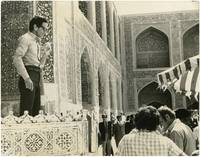 Pier Paolo Pasolini in on the set of Il Fiore Delle Mille E Una Notte [Arabian Nights] (Original press photograph from the 1974 film)