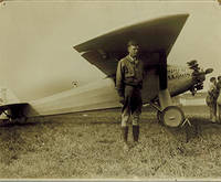 image of Original photograph of Charles Lindbergh next to the Spirit of St. Louis.  Signed