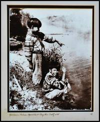Two Miccosukee Children in Native Dress on the Bank of a Stream.