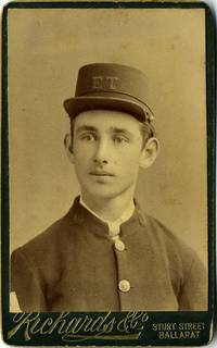 Carte de visite of young Australian man in uniform, with initials E. T. on his cap, possibly Electric Tramway