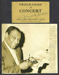 image of Robeson's signature clipped from a London concert program together with US Press Photograph of Robeson holding congratulatory telegrams