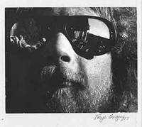 image of Snapshot of man in reflective glasses.