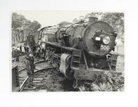 A collection of ten vintage gelatin silver photographs (each approximately 110 x 160 mm) featuring the derailment of a South Australian 500 Class Mountain-type locomotive (Number 506)