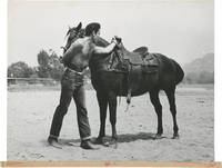 image of Original photograph of Elvis Presley with a horse, circa 1960s