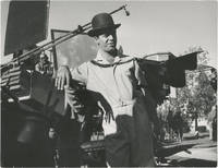 image of Original oversize photograph of Jerry Lewis in a bowler hat and jumpsuit, circa 1960s