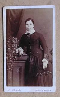 Carte De Visite Photograph. Portrait of a Young Woman in a Fine Dress.