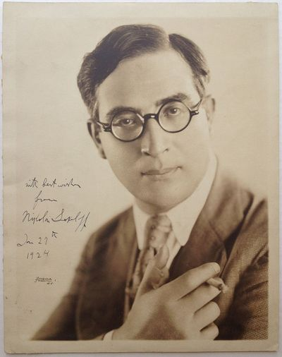 1924. unbound. 10 x 8-inch bust portrait of Sokoloff holding a cigarette. Inscribed (but not persona...