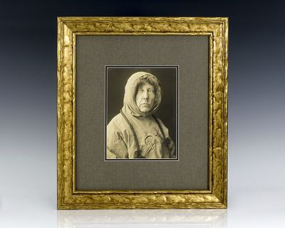 Sepia tone photograph of heroic expedition leader Roald Amundsen in arctic gear. Boldly signed by Ro...