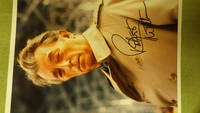 Robert Mitchum SIGNED  Color Photograph With Him Wearing Trenchcoat by SIGNED Robert Mitchum - Signed First Edition - from BLUFF PARK RARE BOOKS (SKU: 8788)