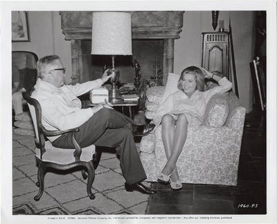 Los Angeles: Mervyn LeRoy Productions, 1965. Two vintage photographs of director Mervyn LeRoy and ac...