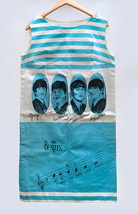 A Signed Beatles dress worn by a programme seller at the world premiere of A Hard Day's Night,...
