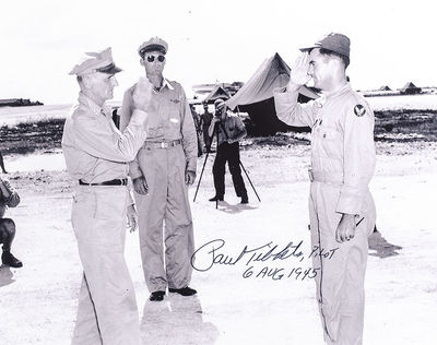 Rare black and white photograph of Paul Tibbets saluting the commander of the Eighth Air Force, Majo...