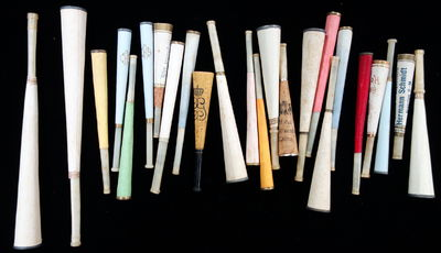 Twenty-four (24) cigarette holders constructed of various papers, celluloid, cork, metal wrings and ...