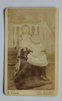 Carte De Visite Photograph: Studio Portrait of Two Young Children with a Toy.